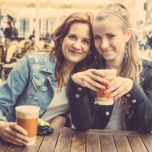 Teenage Girls Drinking at Bar